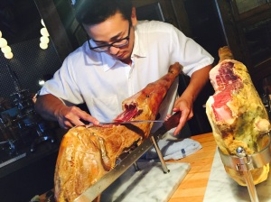 Chef meticulously carving the ham legs at Hamlet